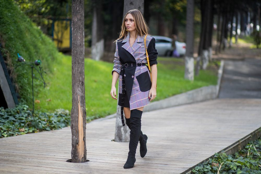 TBILISI, GEORGIA - OCTOBER 28: Demet Kamis wearing checked coat, black overknee boots, yellow bag is seen during Tbilisi Fashion Week Spring/Summer 2018 on October 28, 2017 in Tbilisi, Georgia. (Photo by Christian Vierig/Getty Images)