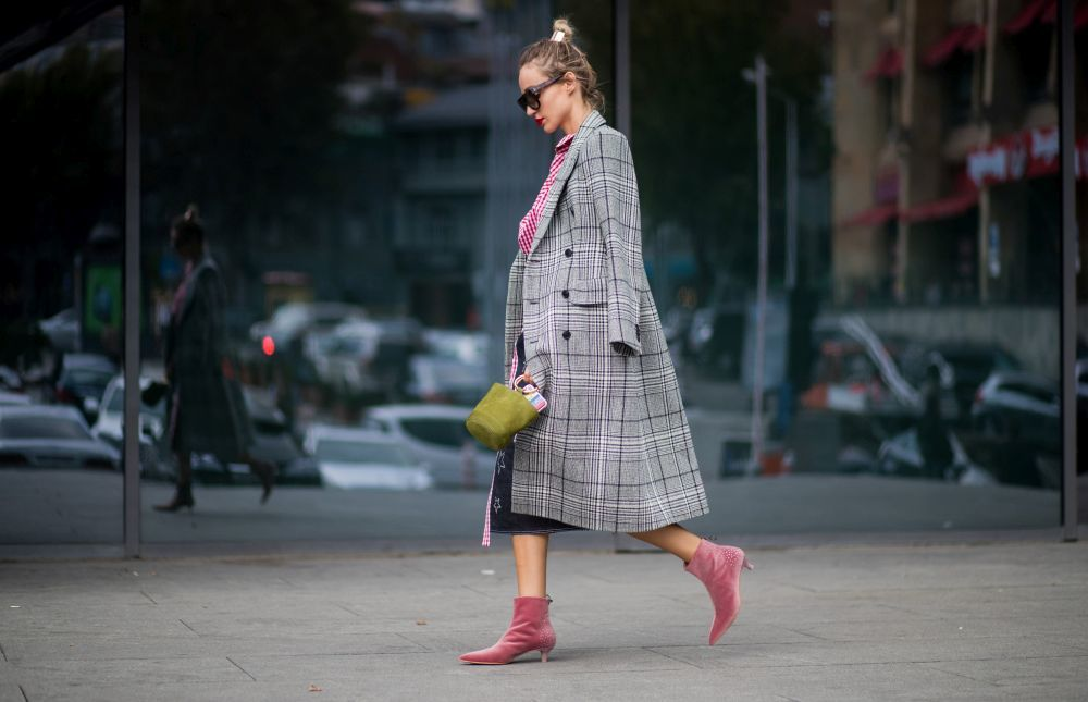 TBILISI, GEORGIA - OCTOBER 29: Designer Anouki Areshidze wearing her own designed denim skirt with star print and red white checked top, Balenciaga checked coat, velvet ankle boots, bag is seen on October 29, 2017 in Tbilisi, Georgia. (Photo by Christian Vierig/Getty Images)