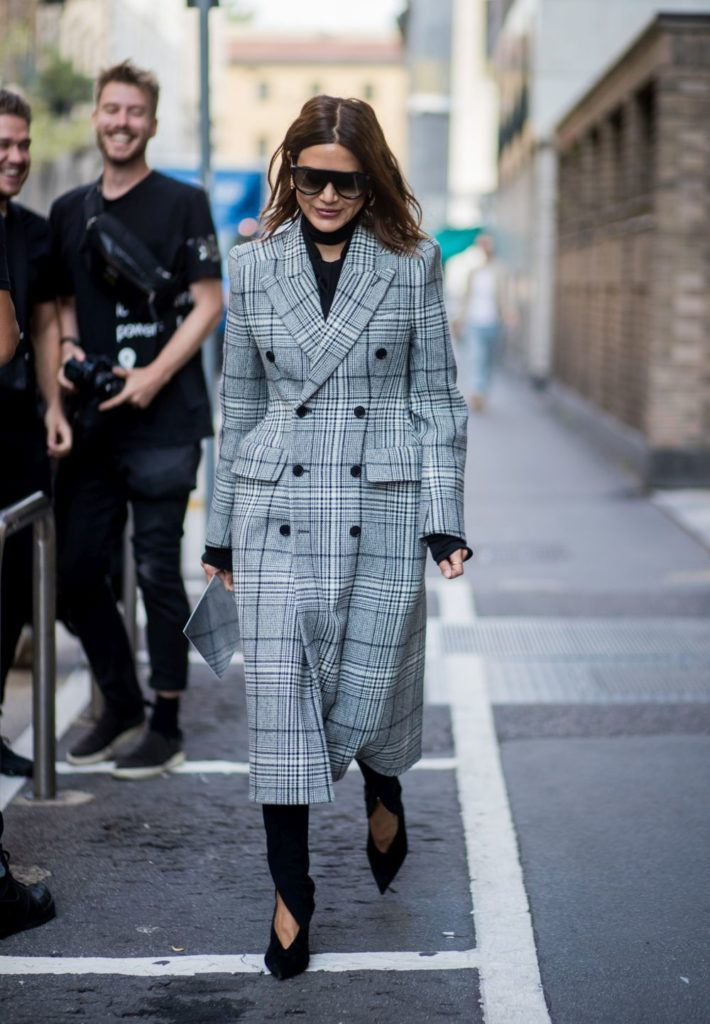 MILAN, ITALY - SEPTEMBER 23: Christine Centenera wearing checked coat is seen outside Bottega Veneta during Milan Fashion Week Spring/Summer 2018 on September 23, 2017 in Milan, Italy. (Photo by Christian Vierig/Getty Images)